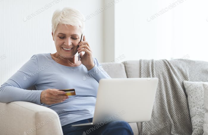 Old lady purchasing online, checking her credit card number
