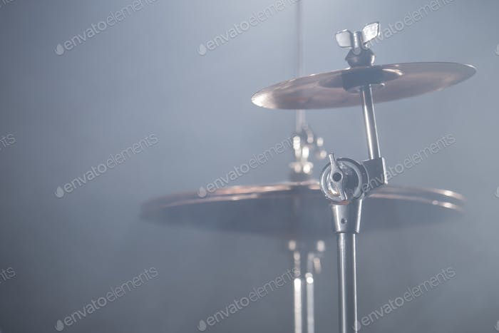 Close-up Drum set in a dark room against the backdrop of the spotlight.