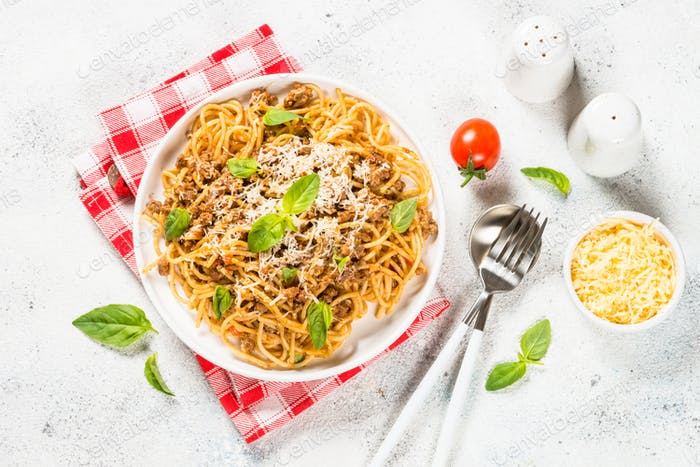 Pasta Bolognese in white plate top view