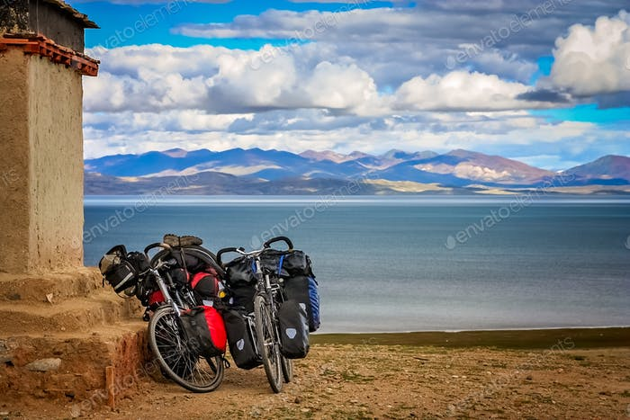 Two cycle touring loaded bicycles on the shore of Lake Manasarov