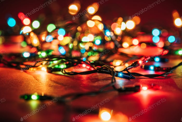 Shining colourful garlands as christmas background