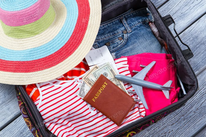 Suitcase with clothes and passport