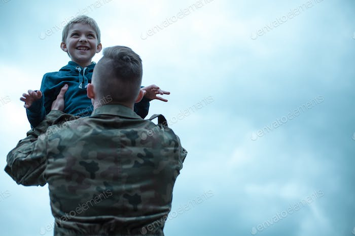 Soldier with his son in his arms