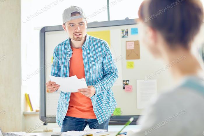 Shocked student talking to groupmate