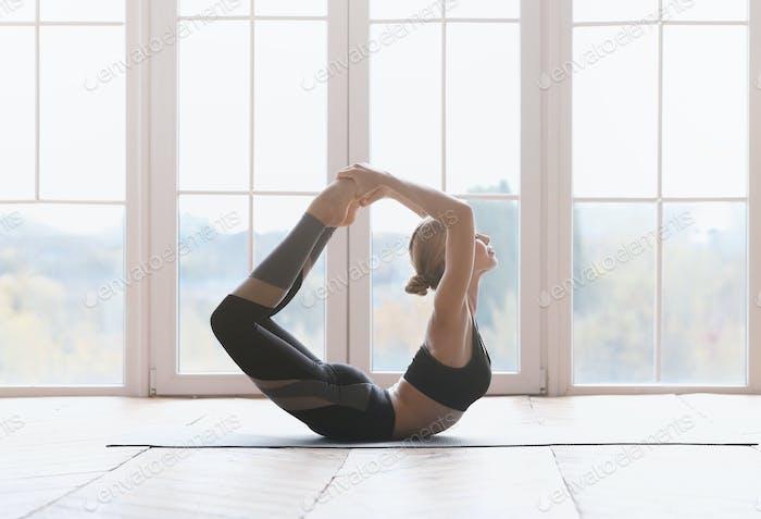 Tiny gymnastic girl exercising at sport studio
