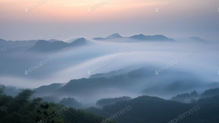 sea of clouds over the mountains at dawn