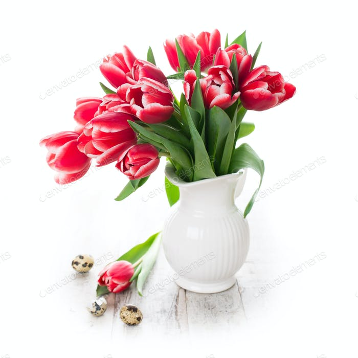 Bouquet of pink tulips in vase on the white background