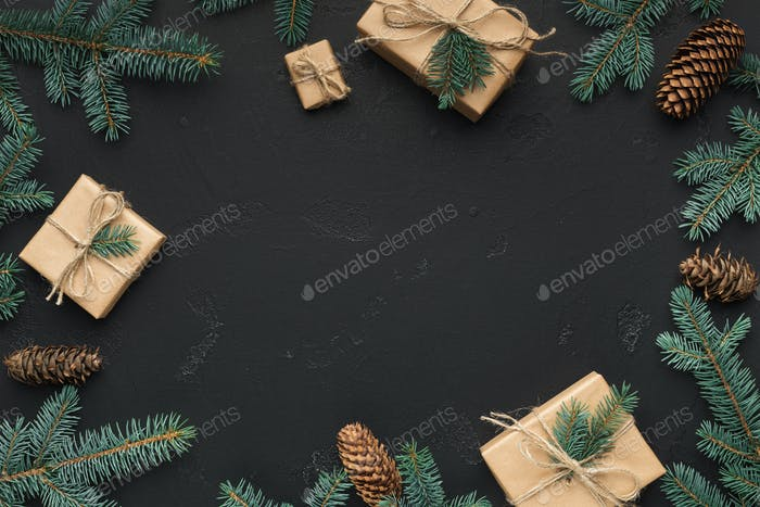 Christmas frame of fir branches and presents