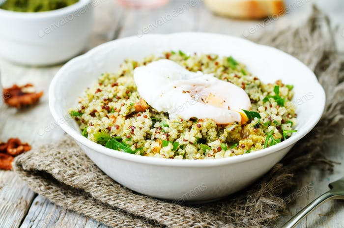 Basil nuts pesto quinoa with walnuts, parsley and poached egg