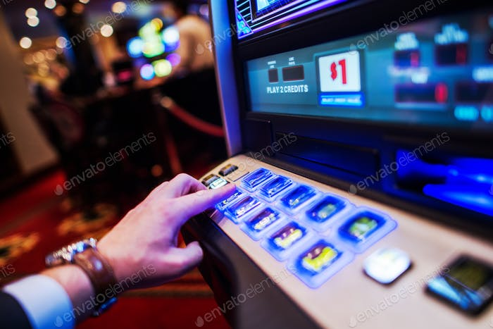 Men Playing Slot Machine