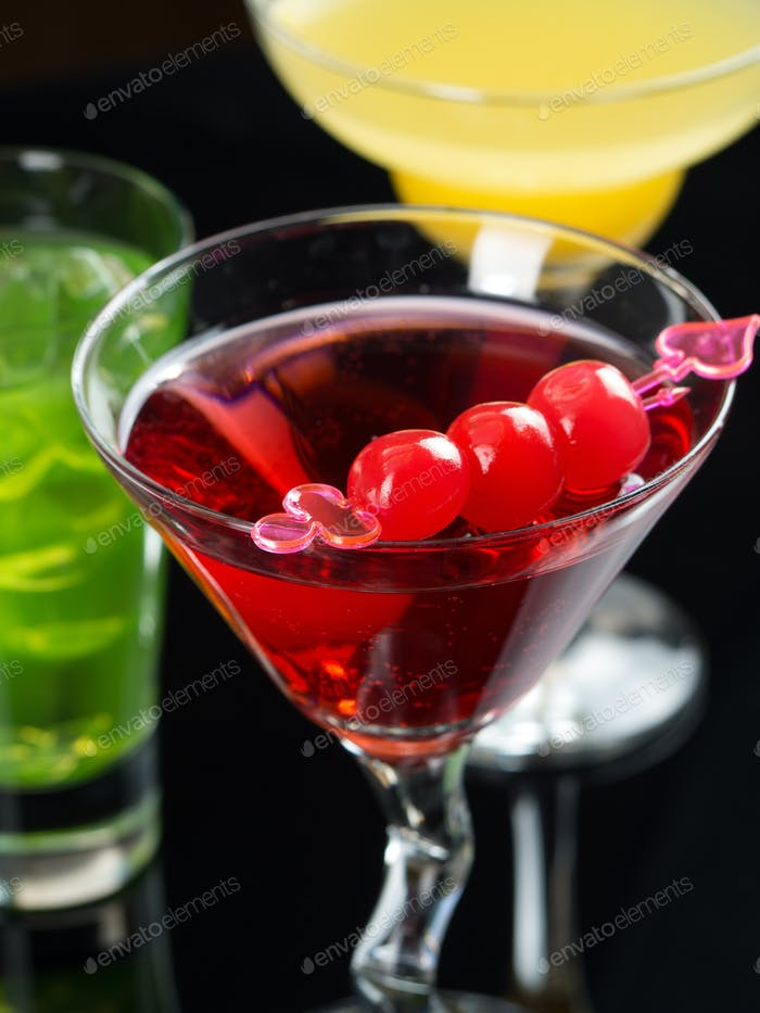 Various cocktails on black background