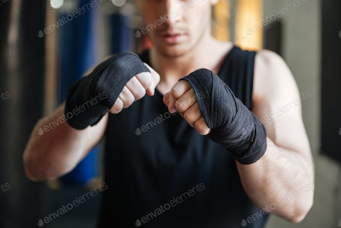 Cropped image of boxer standing in gym