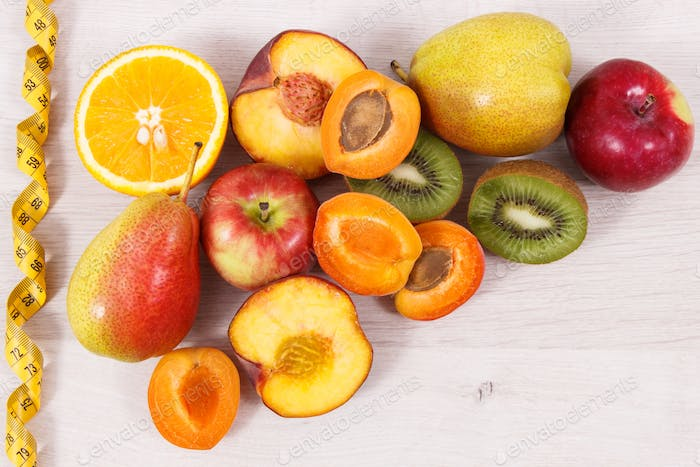 Nutritious fruits as dessert containing natural vitamins and tape measure