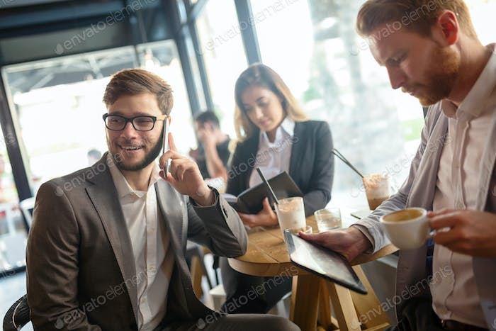 Business people talking and laughing together