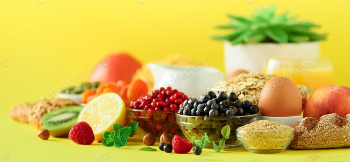 Organic food frame. Banner. Healthy breakfast ingredients. Oat and corn flakes, eggs, nuts, fruits