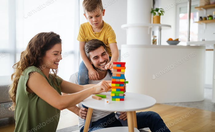 Happy family spending time together, playing at home