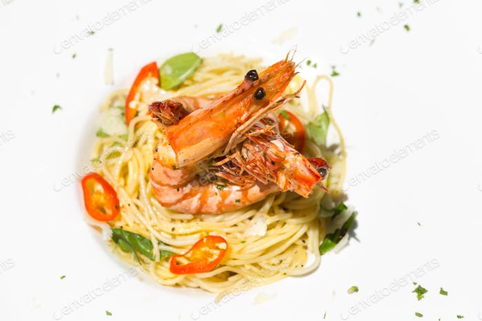 Italian Spaghetti with tiger prawn. Copy Space