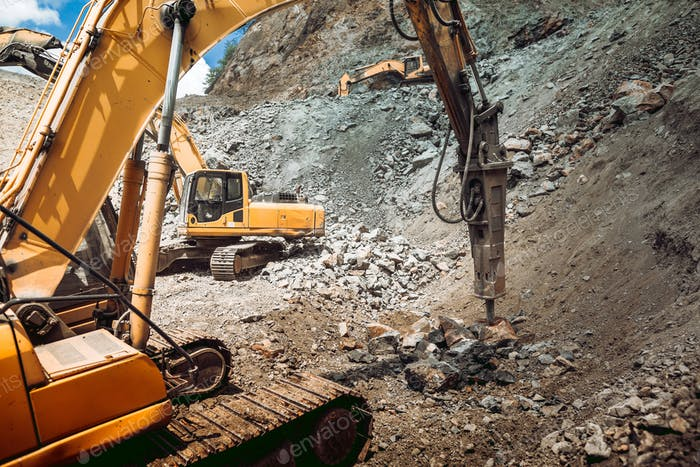 track type excavator and bulldozer working on construction site. Ore quarry and iron ore quarry