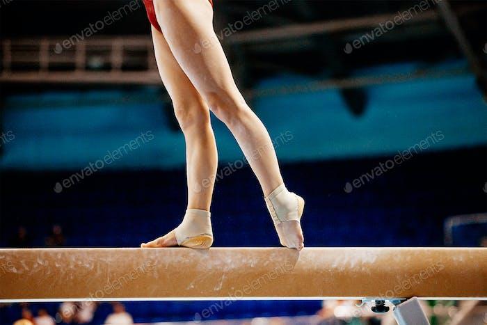 legs women balance beam gymnastics