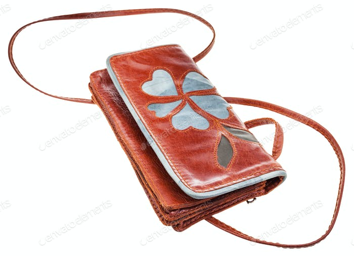 little brown clutch bag decorated floral pattern