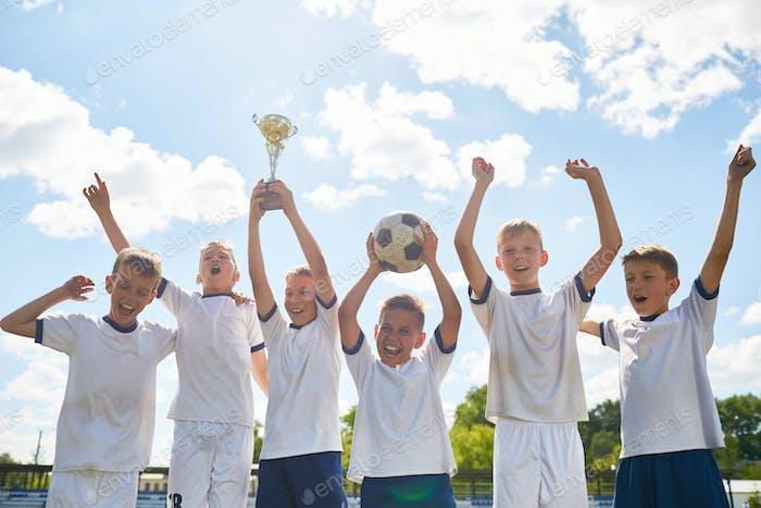 Boys Football Team Winning Champions Cup