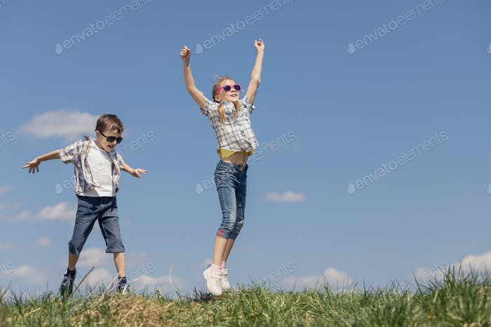 Brother and sister playing on the field