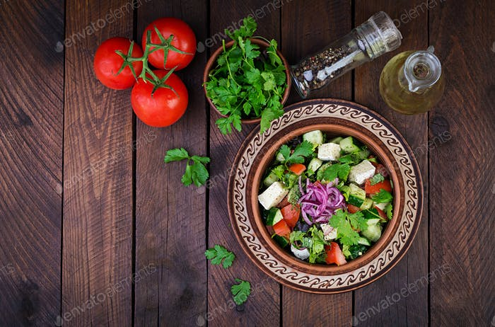 Vegetarian salad with cherry tomato, brie cheese, cucumber, cilantro and red onion.