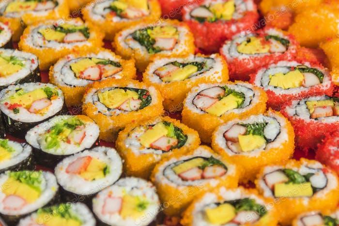 Colorful assortment of Sushi rolls