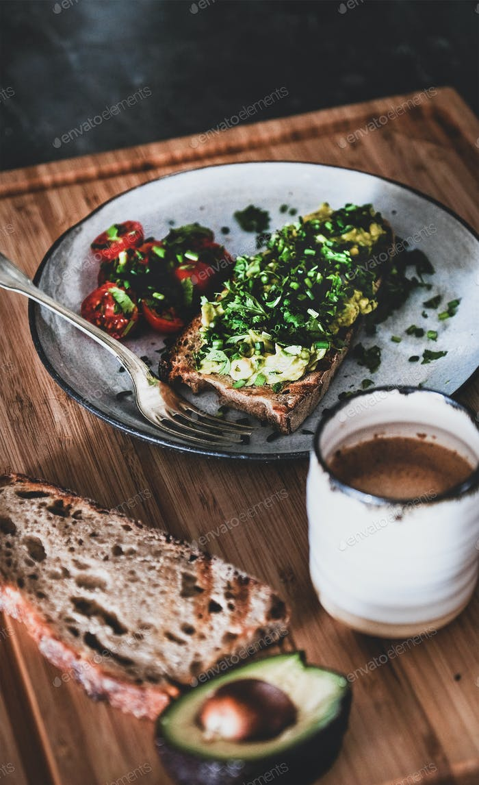 Healthy breakfast with avocado toast and espresso coffee