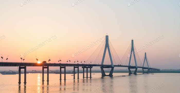 cable stayed bridge with setting sun