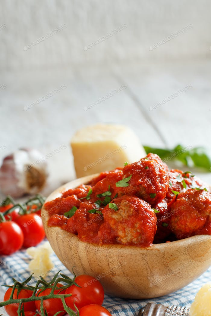 Fresh fried meatballs in a tomato sauce