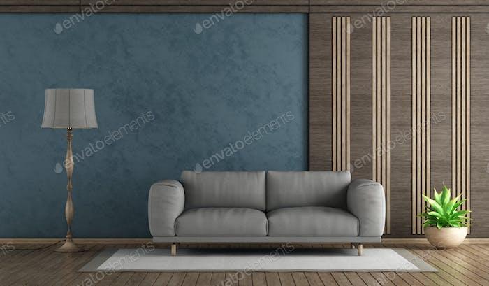 Elegant blue living room withh gray sofa
