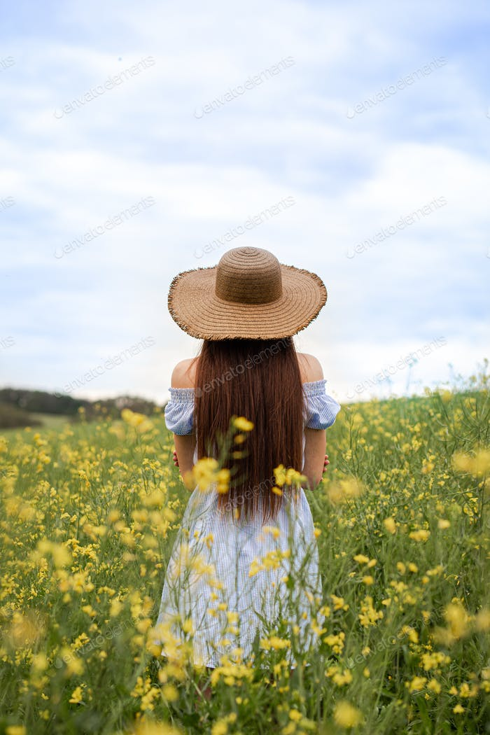Lonely girl in the meadow