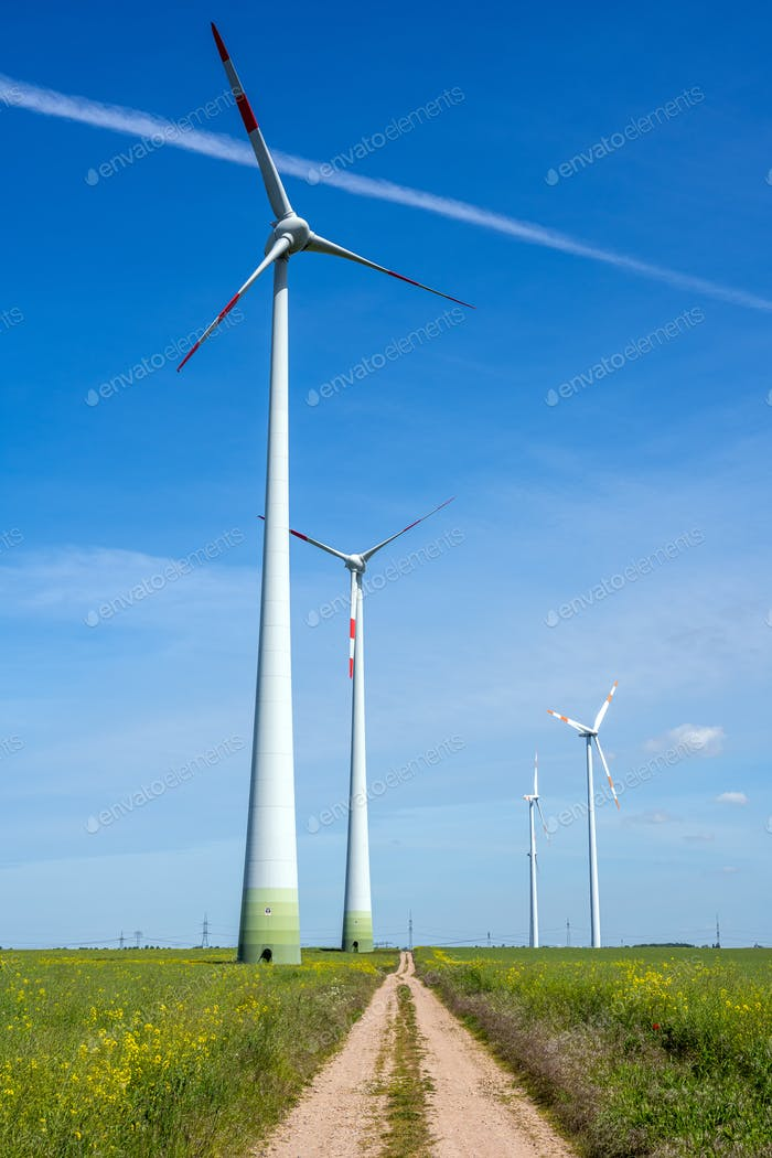 Modern wind energy generators and a country road