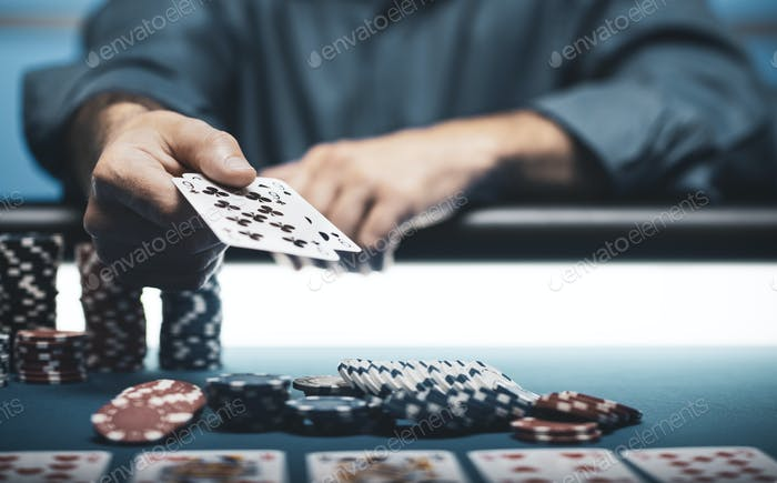 Man playing Texas Hold 'em poker at Casino