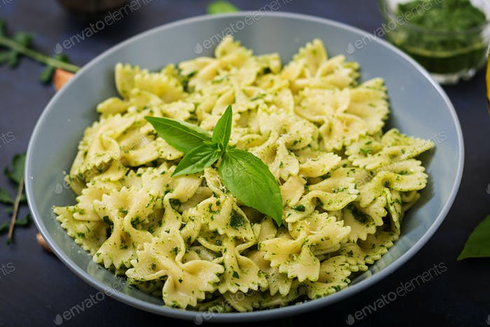 Vegan  Farfalle pasta in a basil-spinach sauce with garlic