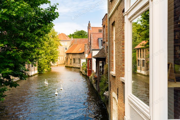 Ancient building facades on river canal, Europe