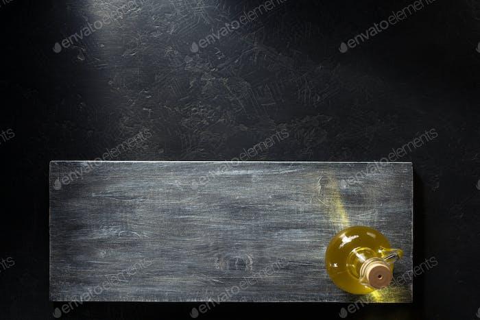 oil in bottle on wood