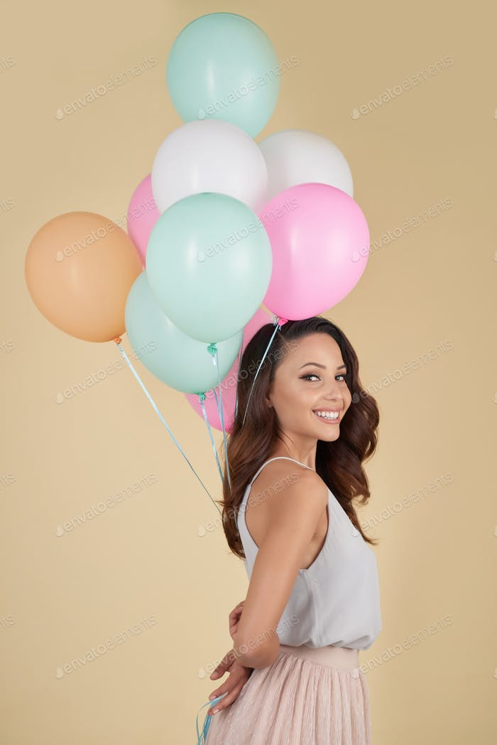 Cheerful girl with balloons