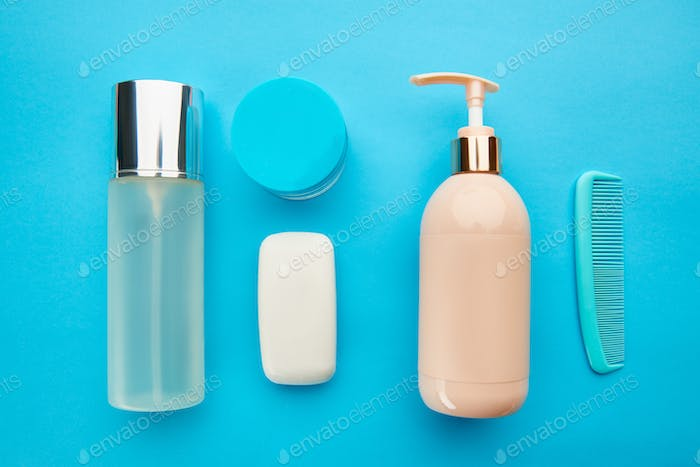 Care products on blue background, nobody