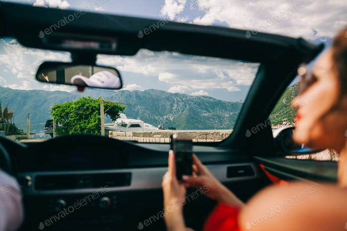woman travel by car cabriolet