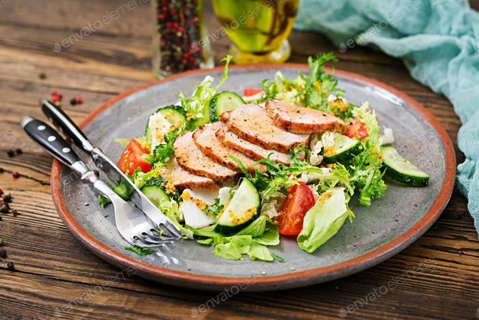 Veal salad with fresh vegetables. Dietary food. Meat salad.