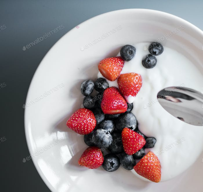 Yogurt with strawberries and blueberries