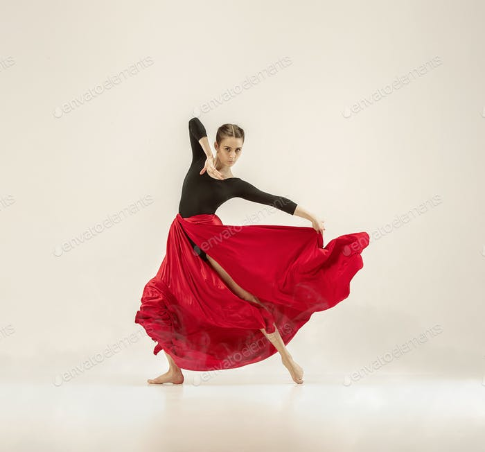 Modern ballet dancer dancing in full body on white studio background.