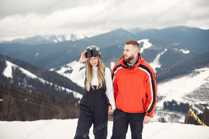 Winter snow couple in a mountains