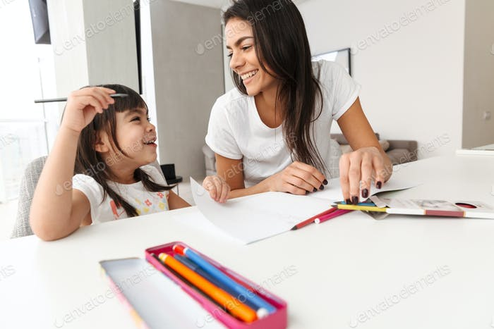 Portrait of smiling family mother and child spending time togeth