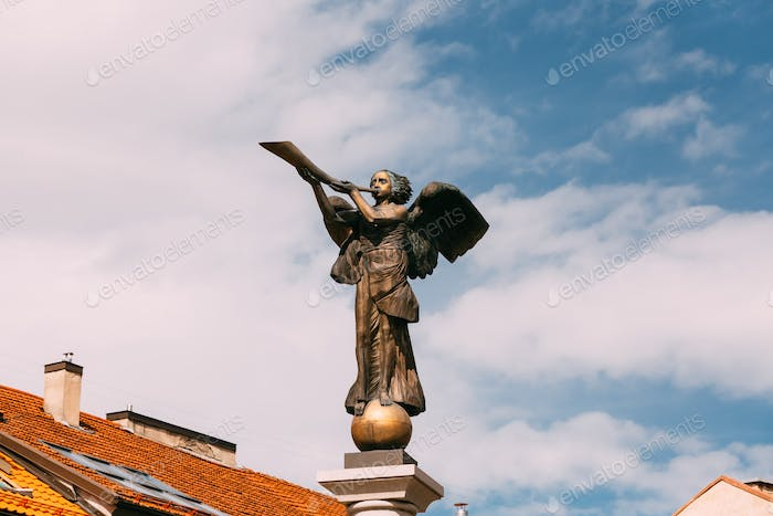 Vilnius, Lithuania. Statue Of An Angel Blowing A Trumpet In Main