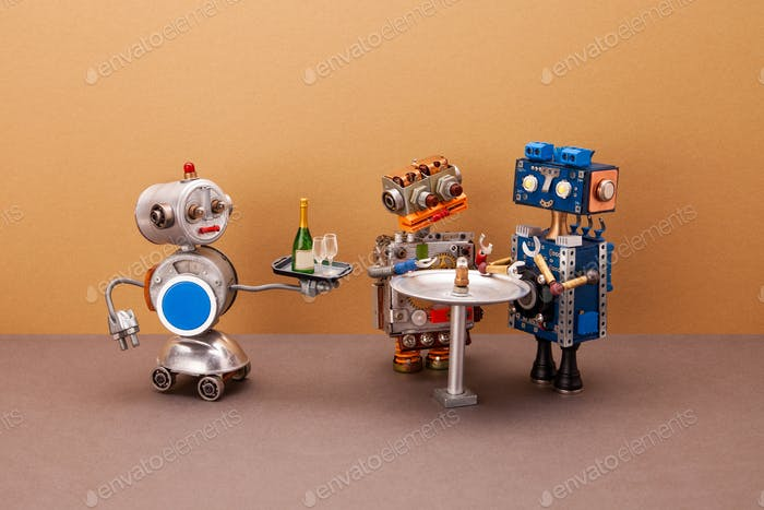 Robot waiter carries a tray with glasses and a bottle of champagne for two guests