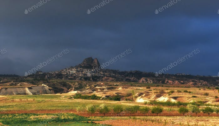 picturesque landscape with a volcanic canyon in storm weather