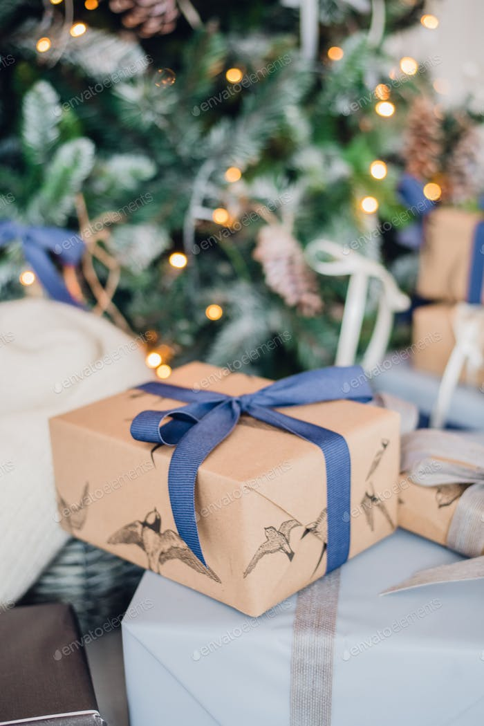 Christmas gift or present box wrapped in kraft paper on christmas decoration